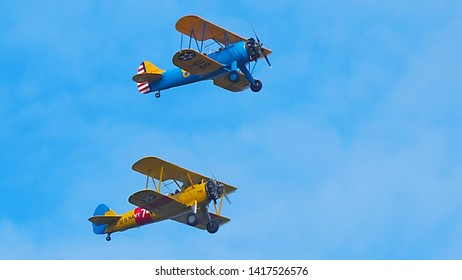 Lynchburg, Virginia / USA - June 6, 2019: Two World-War-II-era Boeing-Stearman trainers just after takeoff from the Lynchburg Regional Airport.