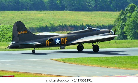 Lynchburg, Virginia / USA - June 6, 2019: A world-War-II B-17 bomber taxying for takeoff at the Lynchburg Regional Airport.