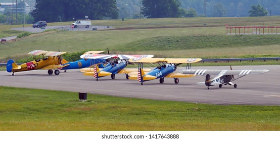 Lynchburg, Virginia / USA - June 6, 2019: Four Boeing-Stearman World-War-II trainers and an L-19 Birddog observation plane lined up for take off at the Lynchburg Regional Airport.