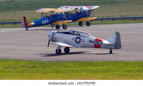 Lynchburg, Virginia / USA - June 6, 2019: A World-War-II-era U. S. Marine T-6 trainer waiting to take off behind two Boeing-Stearman trainers at the Lynchburg Regional Airport.
