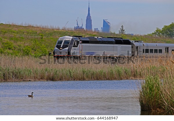 LYNDHURST, NEW JERSEY/USA - MAY 16, 2017: A New Jersey Transit (NJT) Alstom PL42AC locomotive pulling a passenger train through the suburban New York City area.