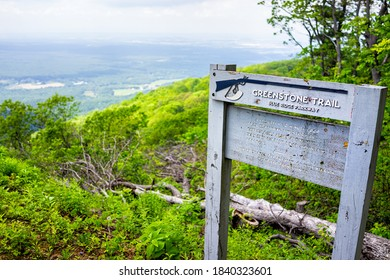Lyndhurst, USA - June 9, 2020: Overlook sign and trailhead for Greenstone Trail at Blue Ridge parkway appalachian mountains in summer with nobody and scenic lush foliage
