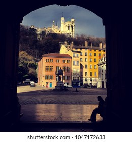 lyon, Rhône Alpes, France  March 12 2018  Instagram picture of the notre dame de fourvière basilica from cathedral saint jean with a beggar on the foreground.