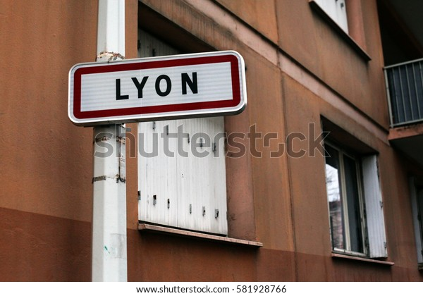 Lyon - a city in France. Road sign on the background of the old house with wooden shutters.
