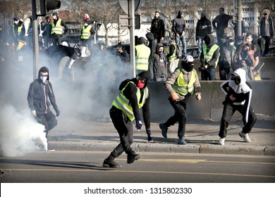 Lyon, FRANCE - 02/16/2019 : About 2000 yellow vests protested against the government's policy and demanded the resignation of the president. Clashes took place with the police throughout demonstration