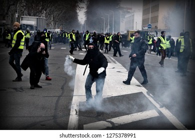 Lyon, FRANCE - 05/01/2019 : Several hundred yellow vests demonstrated in Lyon, and blocked the highway. Clashes took place with the police, some of whom were injured