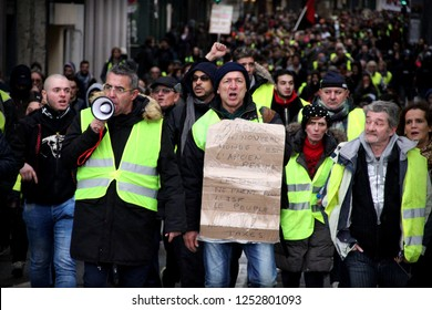 Lyon, FRANCE - 08/12/2018 Clashes with the police during a gathering of yellow vests, in full celebration of lights in Lyon. Installations have been degraded.