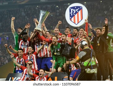 LYON, FRANCE - 16 MAY, 2018: Atletico players and staff celebrate after the UEFA Europa League Final between Olympique de Marseille and Atletico de Madrid at Stade de Lyon.