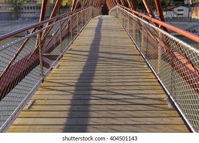 "LYON, FRANCE, April 10, 2016 : ""Passerelle de l'Homme de la Roche"" (Bridge of the man of the Rock) between historic districts along Saone river."