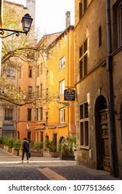 LYON, FRANCE - April 25, 2018: Colorful Rue de Boeuf in Vieux Lyon, the old town of the city of Lyon.