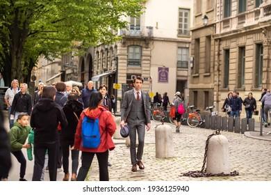 LYON, FRANCE, APRIL 7, 2019: People walk along a narrow street in the historic center of Lyon, France.