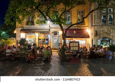 LYON, FRANCE- AUGUST 21, 2018: Bouchon -traditional local restaurant in Lyon where you eat specialties from Lyon and the region. There are 30 Bouchons in Lyon, France.