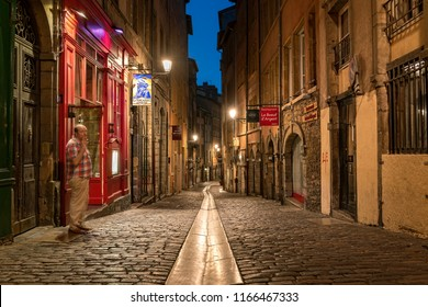 LYON, FRANCE - August 21, 2018: Colorful saint Jean district in old Lyon, the famous and typical old town of the city of Lyon by night. Duboeuf famous old street of Lyon.