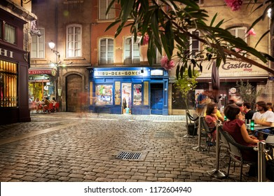 LYON, FRANCE - August 21, 2018: Colorful saint Jean district in old Lyon, the famous and typical old town of the city of Lyon by night. People on the terrace of typical restaurant. Restaurant of Lyon.