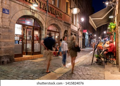 LYON, FRANCE - August 21, 2018: Colorful saint Jean district in old Lyon, the famous and typical old town of the city of Lyon by night. Saint-Jean street is a famous one of old Lyon.