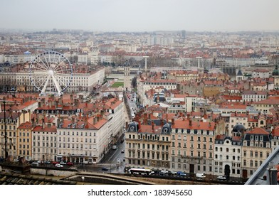 Lyon, France. Bellecour square, traditional buildings and river. Aerial and panoramic view.