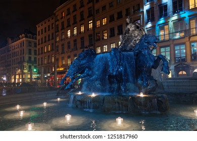 LYON, FRANCE, December 6, 2018 : Bartholdi Fountain during Festival of the lights. For 4 nights, different artists light up buildings, streets mixing splendor of the monuments and artistic creations.