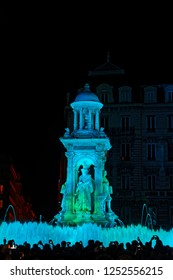 LYON, FRANCE, December 7, 2018 : Smartphones at Jacobins during Festival of lights. For 4 nights, different artists light up buildings, streets mixing splendor of the monuments and artistic creations.