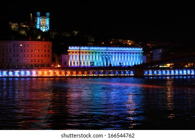 LYON, FRANCE, DECEMBER 8 : Festival of Lights on Saone river monuments, on December 8, 2013 in Lyon, France. Festival of Lights expresses gratitude toward Mary,  around December 8 each year.