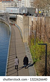 LYON, FRANCE, February 20, 2019 : From Confluence to Barbe Island, the Saone shores are a place of life and well-being for residents and walkers as close to the river as possible.