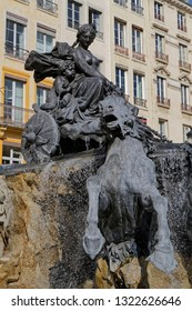 LYON, FRANCE, February 20, 2019 : Fountain Bartholdi, on Place des Terreaux, after its restoration. The fountain depicts France seated on a chariot controlling the four great rivers of France.