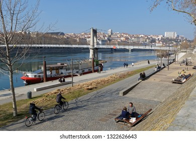 LYON, FRANCE, February 24, 2019 : Furnished by the Grand Lyon, the left banks of the Rhone are organized in two parallel ribbons: one dedicated to soft modes, the other for walking.