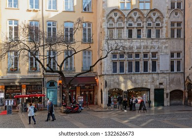 LYON, FRANCE, February 24, 2019 : Place du Change, in 5th district, is one of the most beautiful squares of old Lyon, it is paved, with a bean tree.