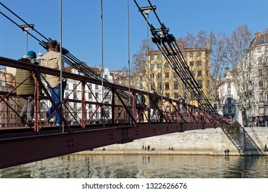 LYON, FRANCE, February 24, 2019 : In the heart of Lyon, Passerelle Saint-Vincent was placed on an elbow of the Saone and allows pedestrians to quickly pass from the Vieux-Lyon to the Presque Ile.