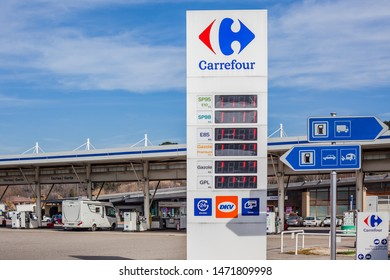 LYON, FRANCE - FEBRUARY 26, 2019: road signs at Carrefour gas service station in Lyon, France on blue sky background