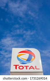 LYON, FRANCE - FEBRUARY 26, 2019: Total, French multinational oil and gas company logo on its gas service station in Lyon, France on blue sky background