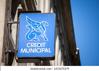 LYON, FRANCE - JULY 13, 2019: Credit Municipal logo in front of their local office in Lyon. This is a Municipal Credit Union, a bank with the pawnbroker monopoly in France