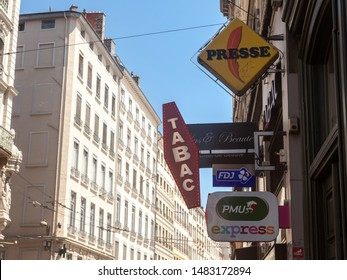 LYON, FRANCE - JULY 14, 2019: French tobacconist sign on a tobaccol seller, selling cigarettes. They are iconic of France, also called buraliste or marchand de tabac