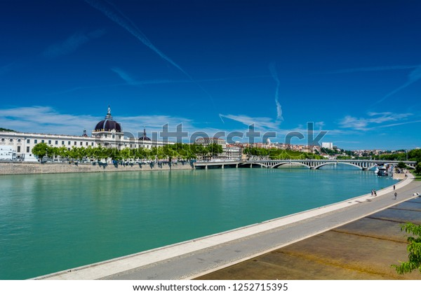 Lyon, France - July 18, 2018:  Rhone river and Hotel-Dieu. Hotel-Dieu was a hospital of historical significance on the west bank of the Rhone, and will be converted to a commercial center