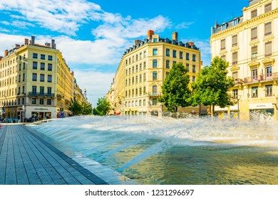 LYON, FRANCE, JULY 22, 2017: Place de la republique in the historical center of Lyon dominated by a large fountain, France