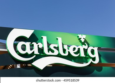 Lyon, France - July 3, 2016: Carlsberg logo on a wall. The Carlsberg Group is a Danish brewing company founded in 1847 by J.C. Jacobsen with headquarters located in Copenhagen, Denmark