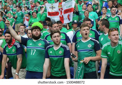 LYON, FRANCE - JUNE 16, 2016: Northern Irish fans show their support during the UEFA EURO 2016 game Ukraine v Northern Ireland at Stade de Lyon stadium in Lyon. Northern Ireland won 2-0