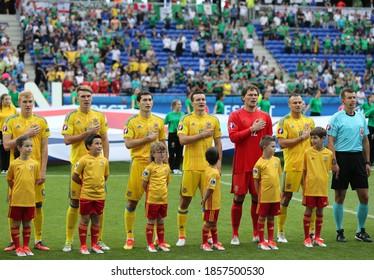 LYON, FRANCE - JUNE 16, 2016: Players of Ukraine national football team listen to national anthem before UEFA EURO 2016 game against Northern Ireland at Stade de Lyon stadium in Lyon