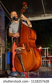 """LYON, FRANCE, June 21, 2018 : Double bass player on stage. With free demonstrations through all the city from June to September, """"Fetons l'été"""" (Let us celebrate the summer) liven up the summer period"""