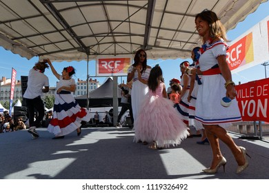 LYON, FRANCE, June 23, 2018 : Dances from Domican Republic. The Fetes Consulaires stand on Place Bellecour around animations, traditional songs, dances, exhibitions prepared by more than 50 consulates