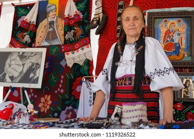 LYON, FRANCE, June 23, 2018 : Old woman from Romania. The Fetes Consulaires stand on Place Bellecour around animations, traditional songs, dances, exhibitions prepared by more than 50 consulates.