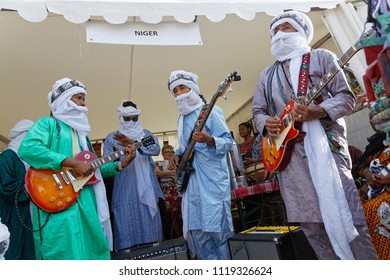 LYON, FRANCE, June 23, 2018 : Guitar players from Niger. The Fetes Consulaires stand on Place Bellecour around animations, traditional songs, dances, exhibitions prepared by more than 50 consulates.