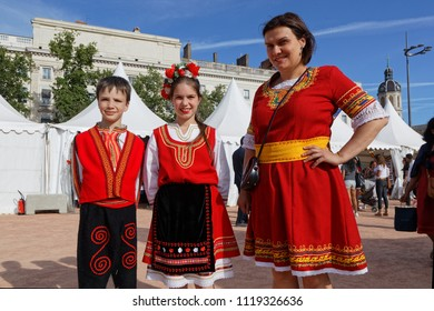 LYON, FRANCE, June 23, 2018 : Family in dress from Bulgaria. The Fetes Consulaires stand on Place Bellecour around animations, traditional songs, dances, exhibitions prepared by more than 50 consulate