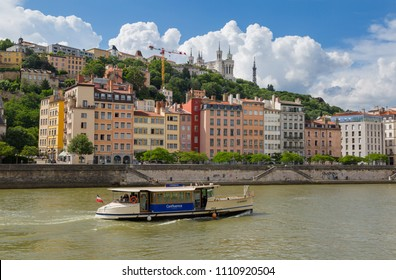 LYON - FRANCE, June 6, 2018: Tour boat on the Saone river in Vieux Lyon on a summers day.