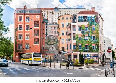 """LYON, FRANCE - JUNE 7, 2016: """"Mur des Canuts"""" (1987) in the Croix-Rousse district. The huge mural is a realistic painting of a Lyon scene, part of the """"Cite de Creation""""."""