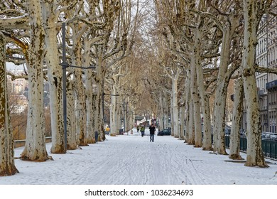 LYON, FRANCE, March 1, 2018 : Pedestrian walkways on Rhone river banks, as a cold spell rages in all Europe and the Capital of Gallia is under the snow.