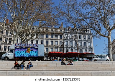 LYON, FRANCE, March 24, 2019 : Berges du Rhone are a series of quays, streets, cycling and walking paths along the Rhone river in Lyon built between 2005 and 2007.