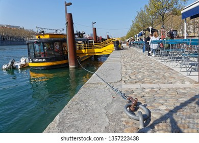 LYON, FRANCE, March 29, 2019 : Berges du Rhone are a series of quays, streets, cycling and walking paths along the Rhone river in Lyon built between 2005 and 2007.