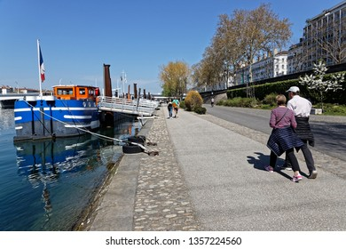 LYON, FRANCE, March 31, 2019 : Berges du Rhone are a series of quays, streets, cycling and walking paths along the Rhone river in Lyon built between 2005 and 2007.