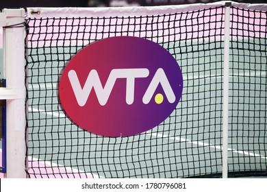 Lyon, France - March 6, 2020: WTA logo on a net. WTA is the principal organizing body of women's professional tennis