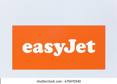 Lyon, France - May 27, 2017: Easyjet logo on a wall. Easyjet is a British airline, operating under the low-cost carrier model, based at London Luton Airport